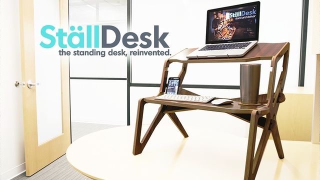 meet the stlldesk a standing desk with an ergonomic design that lets you stay active at work it has multiple shelf heights to accommodate your needs